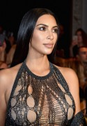Kim Kardashian - Wearing a Mesh See-Thru Bodysuit at the Balmain Fashion Show in Paris 9/29/16
